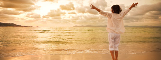 Image of blissful woman on the beach